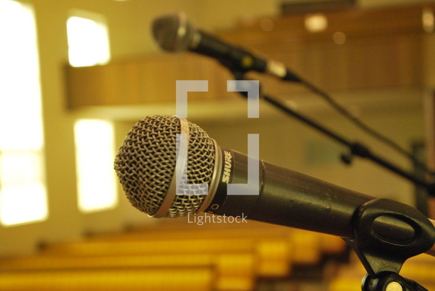 microphone and rows of church pews