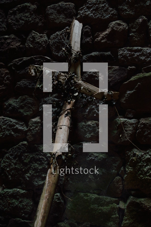 a cross of sticks on stones
