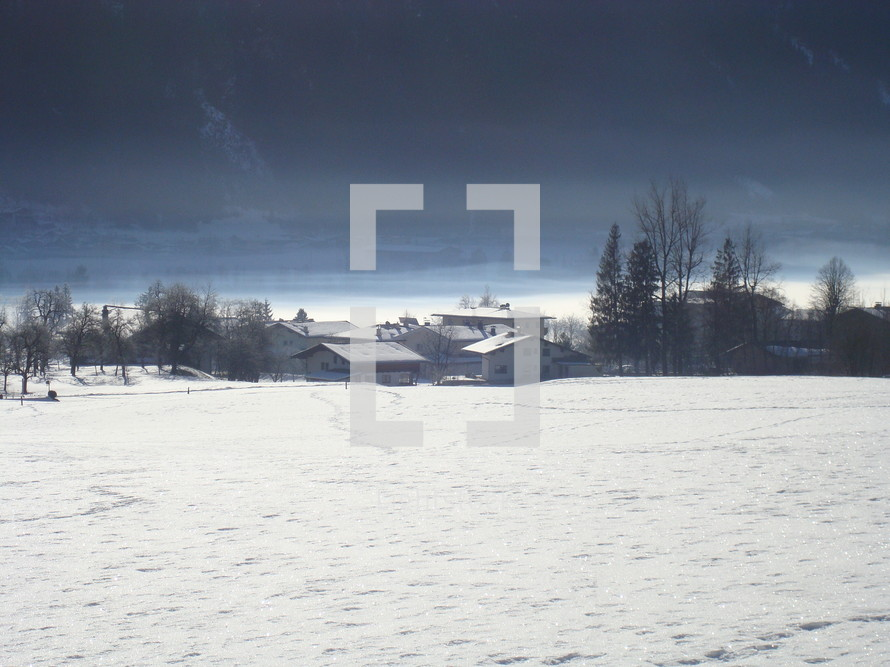 distant houses and footprints in snow