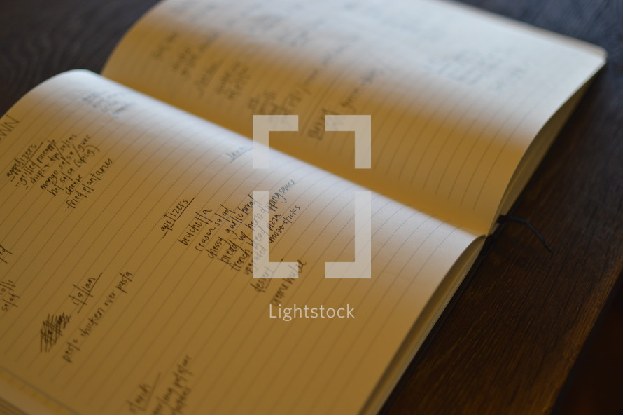 notes in a journal on a table