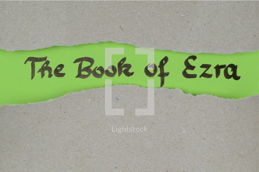 The Book of Ezra - torn open kraft paper over green paper with the name of the book Ezra
