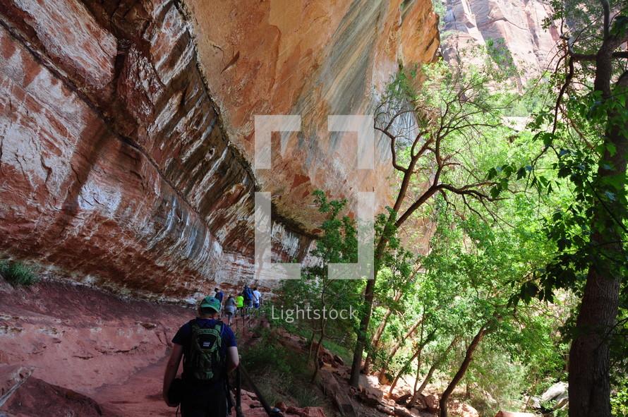 hiking through a canyon trail