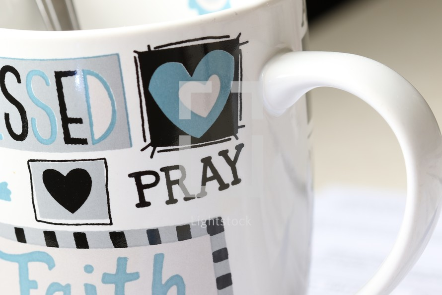 word pray on a coffee mug