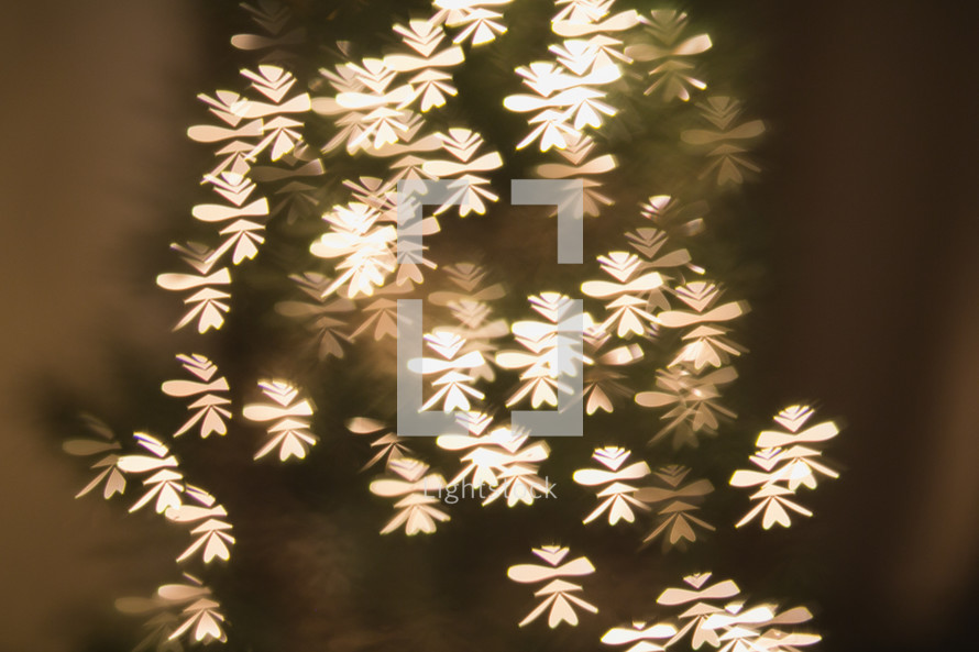 snowflake bokeh white lights on a Christmas tree
