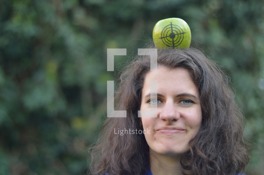 a woman with an apple target on her head