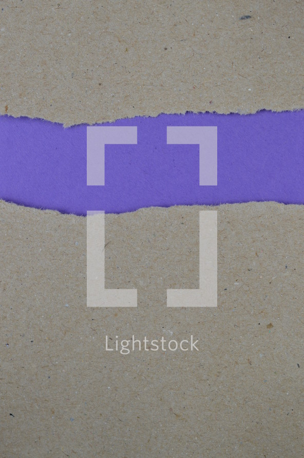torn gray paper with exposed purple underneath