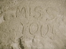 miss you written in the sand