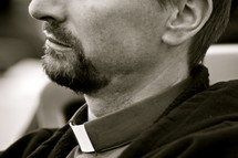 beard on the face of a priest