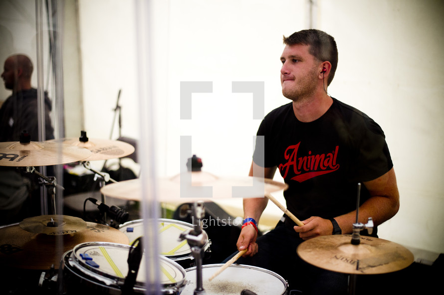 Man playing the drums.