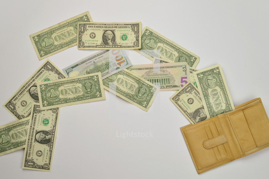cash spilling out of a wallet