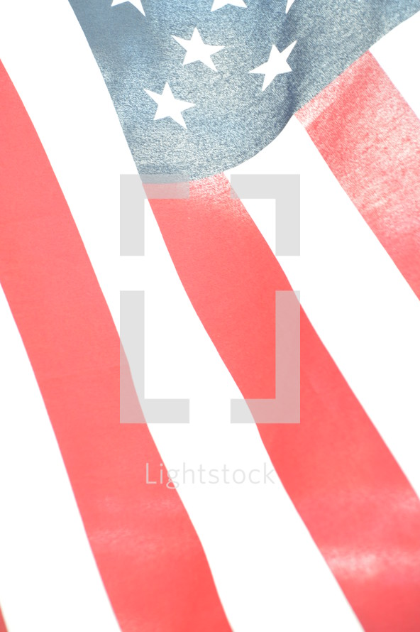 close-up of bright american flag illuminated from behind