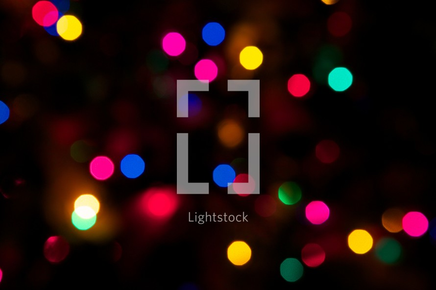 Colored Christmas lights at night.
