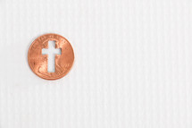 cross cutout in a penny