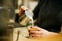 a woman pouring creamer