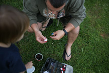 father and son with a tackle box