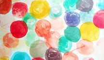 A painting filled with colorful round circles of paint from red, green, yellow primary colors to  aquamarine blue and green cool colors t show a variety of cool soft colors.
