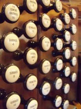 organ knobs that belong to an old pipe organ in a traditional worship church service.