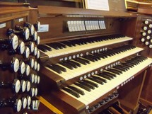keys on an old church organ for a traditional praise and worship service.