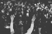 audience with raised hands