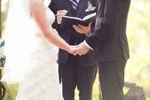 A bride and groom reciting vows.