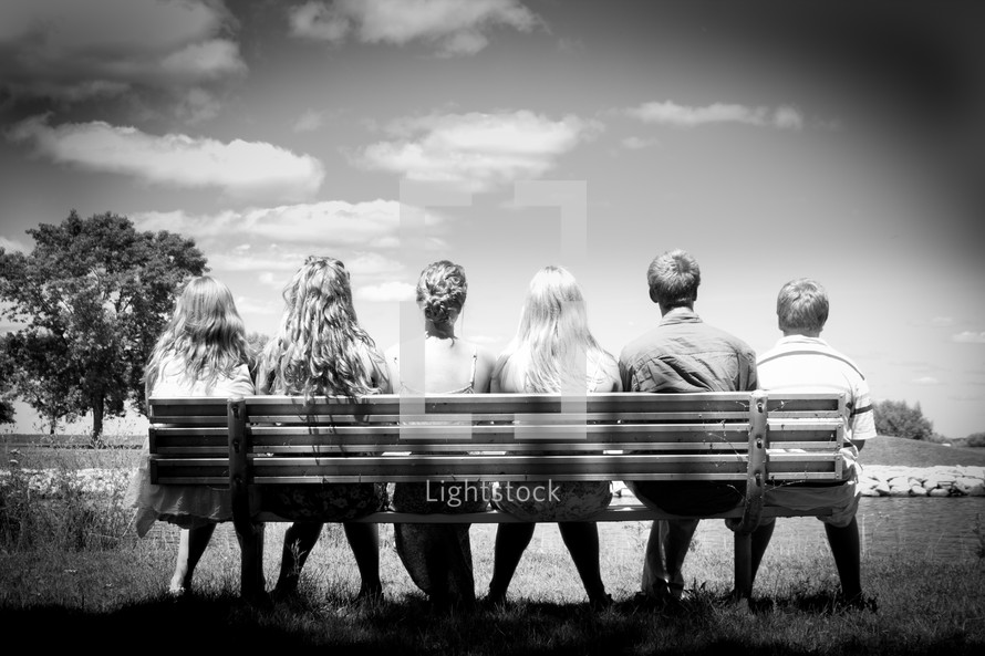 friends sitting on a park bench