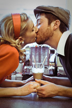 couple kissing on a date