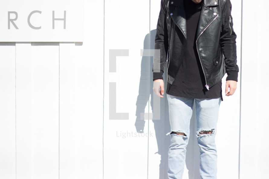 man in a torn jeans and a leather jacket