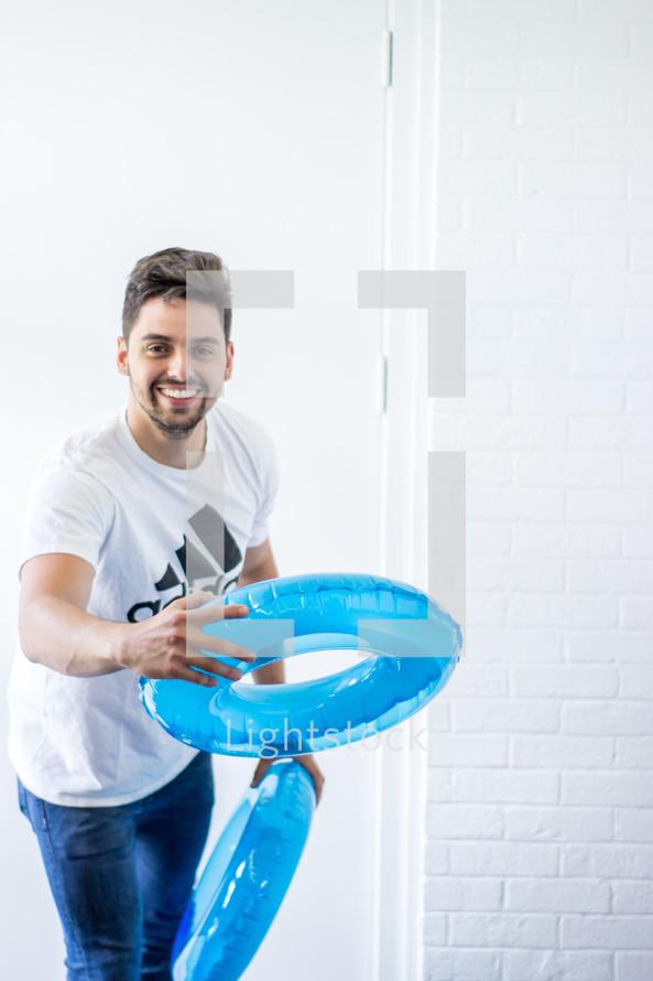 a man tossing floats