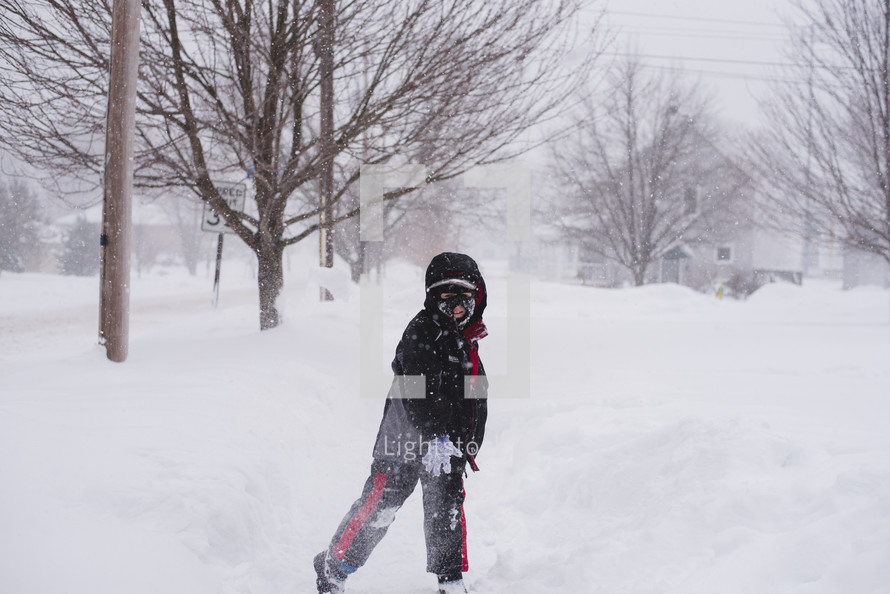 a child throwing a snowball