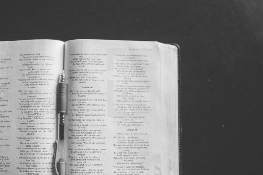 pen in the pages of a Bible