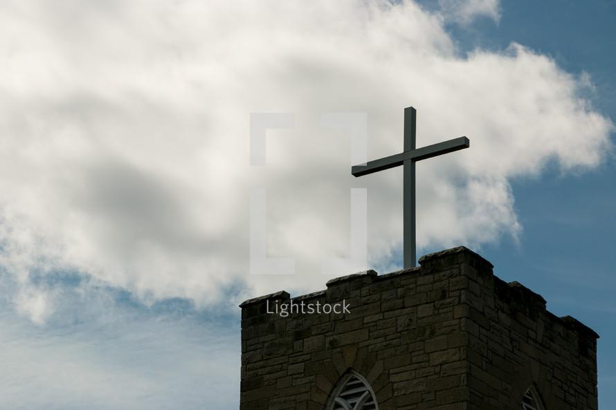 cross topper on a steeple