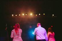 on stage under spot lights