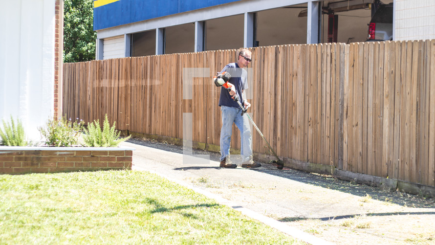 volunteers doing yard work at church