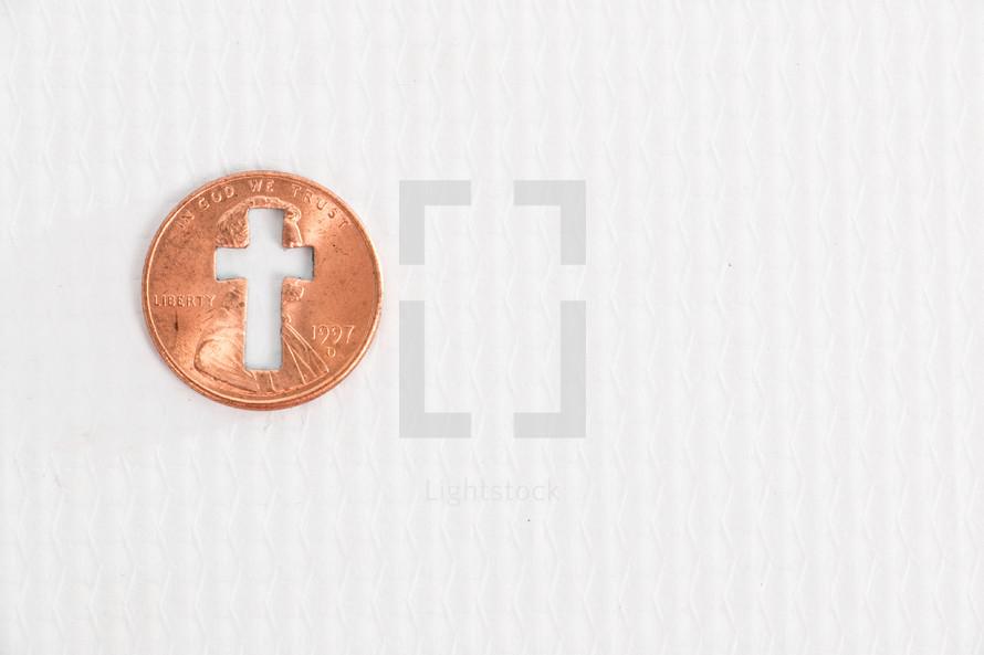 cross cutout in a penny