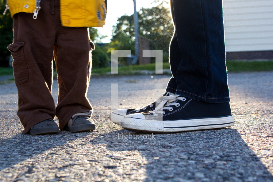 father and son's feet