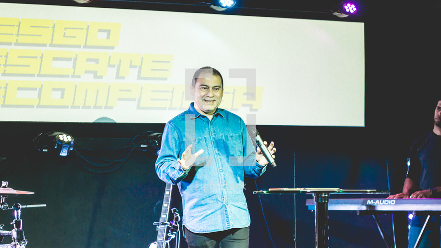 pastor holding a microphone