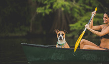 dog and woman in a row boat
