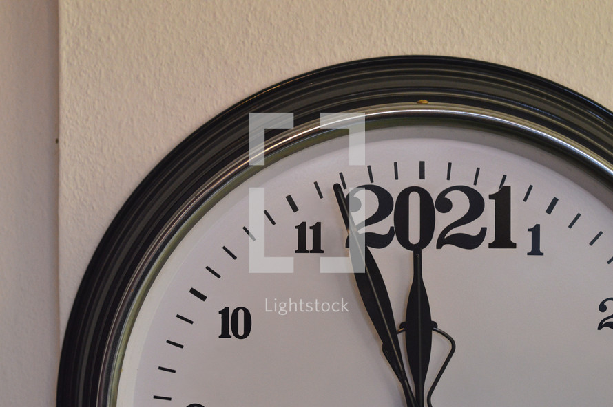 clock with the date 2021 - A clock showing the last minutes before the new year 2021 starts.