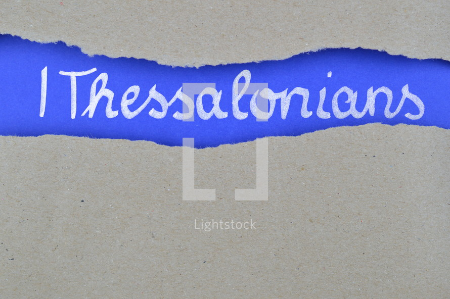 title 1 Thessalonians exposed under gray torn paper