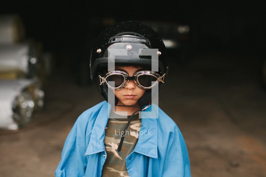 Boy wearing goggles and helmet