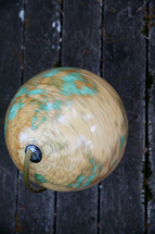 globe on old boards