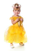 A little girl dressed as a princess.