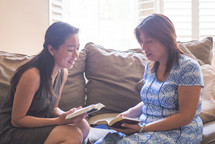 two women praying together at a Bible study
