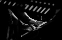 fingers playing on a keyboard