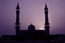 mosque towers at dusk