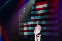 soldier in front of large american flag