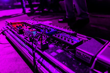 Sound equipment on a stage guitar pedal board
