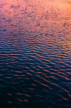 ripples in water at sunset