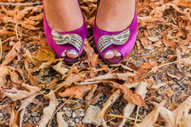 toes peeking through pink dress shoes fall leaves
