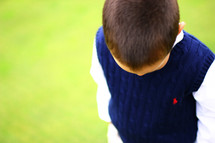 boy look down at grass
